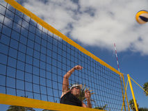 Athletic man hits volleyball Stock Photo