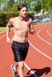 Athletic Man Jogging Stock Photography