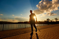 Athletic man after jogging in the rays of the evening sun. Sport Stock Images