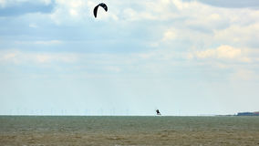 Athletic man jump on kite surf board Stock Photos