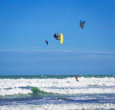 Athletic man jump on kite surf board in sea waves Stock Photo