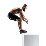 Athletic man jumping onto a box as part of an exercise routine. Stock Photography