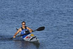 Athletic man in kayak. An athletic man is showing off his kayaking skills in calm waters of Mission Bay, San Diego, California Stock Photos