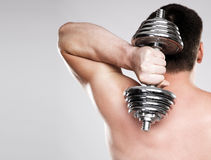 Athletic man lifting a dumbbell Stock Photo
