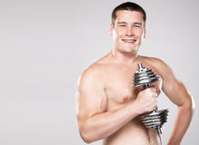 Athletic man lifting a dumbbell Stock Image