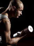 Athletic man Lifting Weights Stock Photos