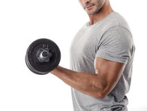 Athletic man lifting weights Royalty Free Stock Image