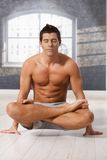 Athletic man in lotus posture Stock Photography