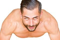 Athletic man making push ups Stock Image
