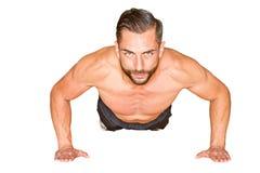 Athletic man making push ups. Isolated on white background Stock Photo