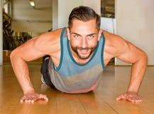 Athletic man making push ups Stock Images