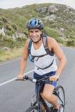 Athletic man mountain biking Royalty Free Stock Photo