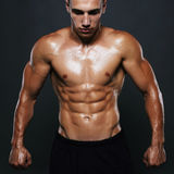 Athletic man.muscular fitness boy Stock Photography
