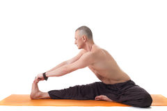 Athletic man with naked torso practicing yoga Stock Photos