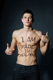 Athletic man with naked torso. Sign Made in Moldova Royalty Free Stock Photo