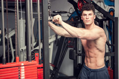 Athletic man with no shirt exercising in the gym. Sport lifestyle Royalty Free Stock Image
