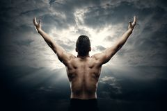 Athletic Man Open Arms on Sunrise Sky, Muscular Athlete Body Back View royalty free stock photography
