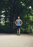 Athletic Man at the Park with Hands on Waist Royalty Free Stock Image