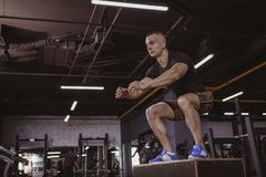 Athletic man performing crossfit workout at crossfit box stock photos