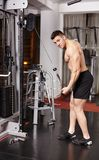 Athletic man pulling heavy weights Royalty Free Stock Photography