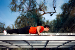Athletic Man in Push-up Plank Position Training Royalty Free Stock Photography