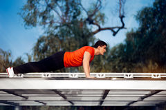 Athletic Man in Push-up Plank Position Training Royalty Free Stock Image