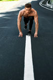 Athletic Man Ready To Start Running Outdoors. Sports Workout Concept Stock Photos