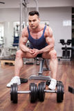 Athletic man resting on a bench at the gym Royalty Free Stock Photo