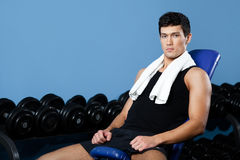 Athletic man rests in gym class Stock Photography