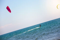 Athletic man riding on kite surf board on a sea waves Royalty Free Stock Image