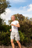 Athletic man runner jogging in nature outdoor Royalty Free Stock Photography