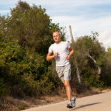 Athletic man runner jogging in nature outdoor Stock Photography