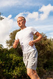 Athletic man runner jogging in nature outdoor Stock Images