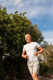 Athletic man runner jogging in nature outdoor Stock Photo