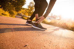 Athletic man runner touching foot in pain due to sprained ankle Royalty Free Stock Photos