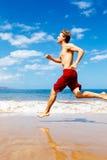 Athletic Man Running on Beach Royalty Free Stock Photo