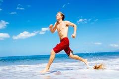 Athletic Man Running on Beach Royalty Free Stock Photos
