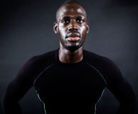 Athletic man running in black background. Royalty Free Stock Photo