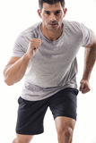 Athletic man running. An athletic man running, isolated over a white background Royalty Free Stock Images