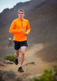 Athletic man running jogging outside, training. Athletic man jogging outside, training outdoors. Running on nature trail Royalty Free Stock Image