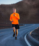 Athletic man running jogging outside Royalty Free Stock Photo