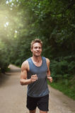 Athletic Man Running at the Park in the Morning Royalty Free Stock Image