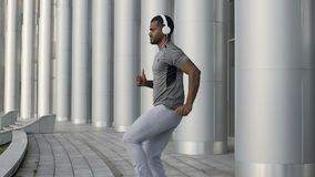 Athletic man running in place in slow-motion, exercising and lifting legs. Stock footage stock video