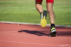 Athletic man running. On track Royalty Free Stock Image