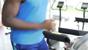 Athletic man running on treadmill at the gym, active lifestyle and sport. Stock footage stock video footage