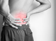 Athletic man`s back pain isolated in black and white stock images