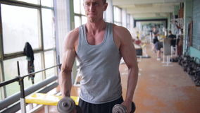Athletic man. Shoulders workout stock footage