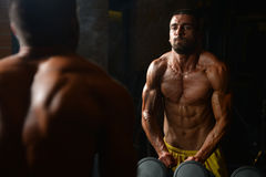 Athletic Man Showing His Muscles In Gym Royalty Free Stock Photo
