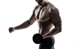 Athletic man showing muscular body and doing exercises with dumbbells Stock Image