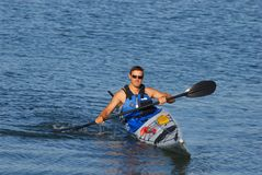 Athletic man showing off his m. Athletic man is showing off his mastery of kayaking at Mission Bay, San Diego under a warm light of late summer afternoon Royalty Free Stock Photo